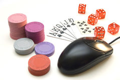 Online poker. Online gaming and gambling concept, red dice, mouse, cards and casino chips on a white background stock images