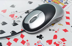 Online poker. Mouse and playing cards, internet poker concept Stock Photos