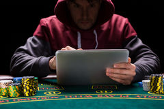 Online poker players sitting at the table Stock Image