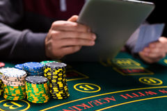 Online poker players sitting at the table Stock Images