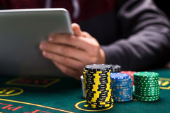 Online poker players sitting at the table Stock Photo