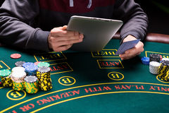 Online poker players sitting at the table Royalty Free Stock Photography