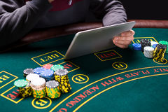 Online poker players sitting at the table Royalty Free Stock Image