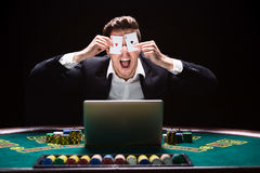 Online poker players sitting at the table Stock Photos