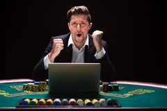Online poker players sitting at the table Stock Photography