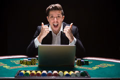 Online poker players sitting at the table Royalty Free Stock Photo