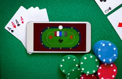 Free Online Poker Table On Smartphone Screen Stock Photo - 117200950