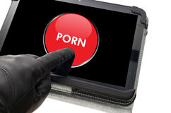 Online porn concept. On-line mobile pornography concept with hand wearing black glove pointing a touch screen Stock Photography