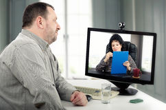 Online psychotherapist face-to-face with patient Stock Photos