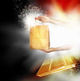 Online purchase. A plain paper bag ready for text or copy being held by two arms and exploding from a laptop monitor screen. Concept for e-commerce and shopping