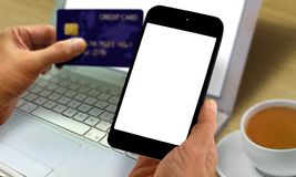 Online purchase concept. Using credit card and smart phone Stock Photography