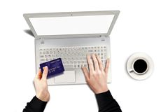 Online purchase using credit card and laptop. Over white Stock Photography