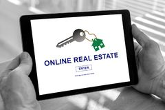 Online real estate concept on a tablet. Male hands holding a tablet with online real estate concept royalty free stock photo