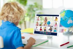 Free Online Remote Learning. School Kids With Computer Royalty Free Stock Photo - 180886405