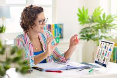 Free Online Remote Learning. Teacher With Computer Stock Photo - 181738660