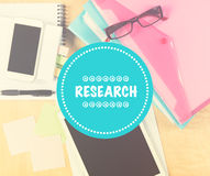 Online research concept. Messy office table with digital tablet, phone and filling folders Royalty Free Stock Images