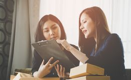 Online retail business partner discussing sale report data. Online retail business partner is discussing sale report data royalty free stock images