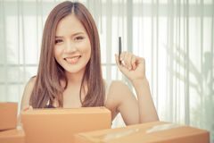 Online Retail e commerce business woman writing package for customer. Online Retail e commerce business woman is writing package for customer stock image