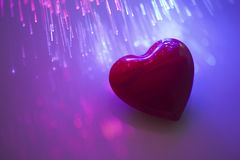 Online romance. Heart with fiber optical background Stock Photo