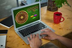Composite image of online roulette game stock photo