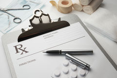 Online rx prescription concept pills. Pen stethoscope and bandages stock images