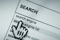 Online search engine page. Close up of computer generated screen with browser showing related search Royalty Free Stock Image