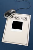 Online searching. Computer mouse and wanted poster, online searching royalty free stock photography