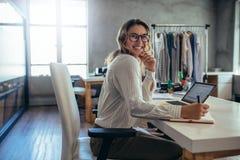 Online seller businesswoman at office. Caucasian online seller businesswoman working at office. Female entrepreneur taking online orders royalty free stock images
