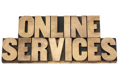 Online services in wood type Stock Images