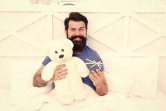 Online shop. my birthday. Happy adulthood. home shopping concept. Love and happiness. bearded man teddy bear in bed