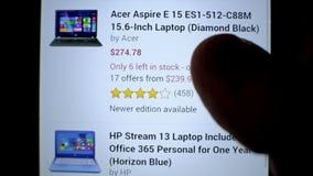 Online shop website on touchscreen display Buy new. KRASNODAR, RUSSIA - APR 10, 2015: Surfing online shop website on touchscreen display. Buy and sell new modern stock video
