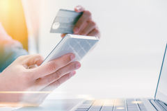 The online shoping card and holding credit card with hand for pa Stock Images