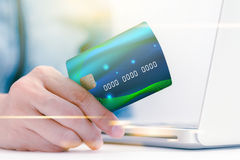 The online shoping card and holding credit card with hand  Stock Photo