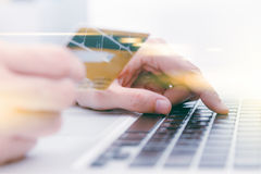 The online shoping card and holding credit card with hand  Stock Image