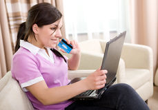 Online shopping. Young adult woman buying something online stock images