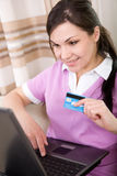 Online shopping. Young adult woman buying something online Royalty Free Stock Photos