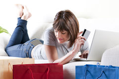 Online Shopping. Woman doing online shopping at home Royalty Free Stock Photography