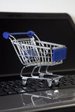 Online shopping. Shopping cart on notebook stock photo