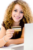 Online Shopping. A young pretty woman with laptop computer and credit card on white background royalty free stock photography