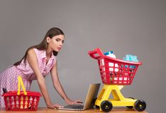 Online shopping app. happy girl enjoying online shopping. retro woman go shopping with full cart. savings on purchases stock images