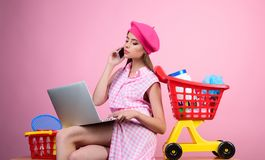 Online shopping app. savings on purchases. retro woman go shopping with full cart. happy girl enjoying online shopping royalty free stock photos