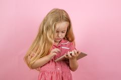 Online shopping is a bad habit of mine. Small girl in e shop. Little girl shopping on smartphone. Little shopaholic. Shopping online. Small shopper use mobile royalty free stock photos