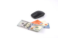 Online Shopping. Black computer mouse, 100 dollar bill and three bank cards isolated on white background, shopping online Royalty Free Stock Images
