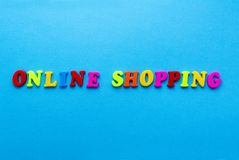 Online shopping on blue background royalty free stock image