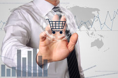Online shopping. Business man pressing shopping cart icon, concept for growing online shopping Royalty Free Stock Photos