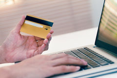 The online shopping card and holding credit card with hand for p Royalty Free Stock Photography