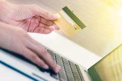 The online shopping card and holding credit card with hand for p Stock Images