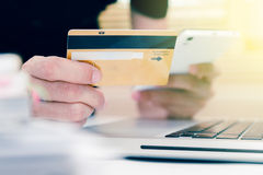 The online shopping card and holding credit card with hand for p Stock Photos