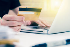 The online shopping card and holding credit card with hand for p Stock Photo