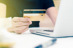The online shopping card and holding credit card with hand for p Royalty Free Stock Images